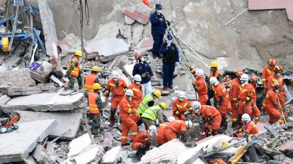 """Rescuers search for victims at the site of a <a href=""""https://www.cnn.com/2020/03/07/china/china-coronavirus-hotel-collapse/index.html"""" target=""""_blank"""">collapsed hotel</a> in Quanzhou, China, on March 8. The hotel was being used as a coronavirus quarantine center."""