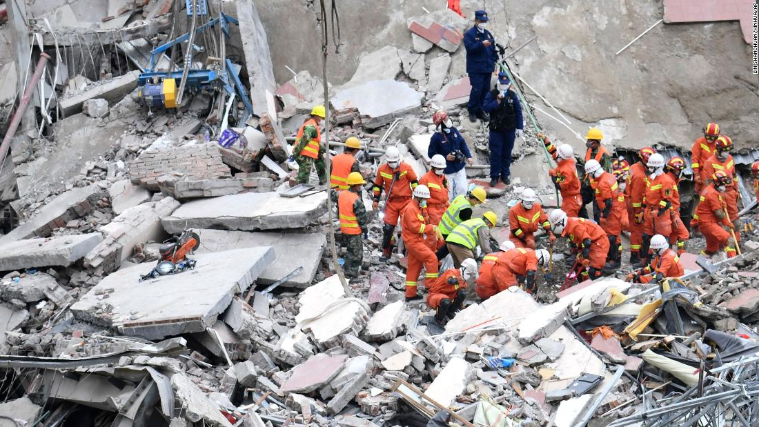 "Rescuers search for victims at the site of a <a href=""https://www.cnn.com/2020/03/07/china/china-coronavirus-hotel-collapse/index.html"" target=""_blank"">collapsed hotel</a> in Quanzhou, China, on March 8. The hotel was being used as a coronavirus quarantine center."