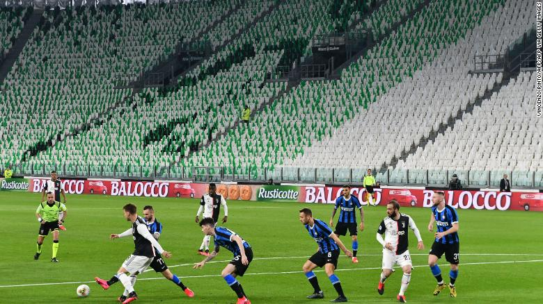 Inter Milan and Juventus players compete in an empty stadium due to the novel coronavirus outbreak.