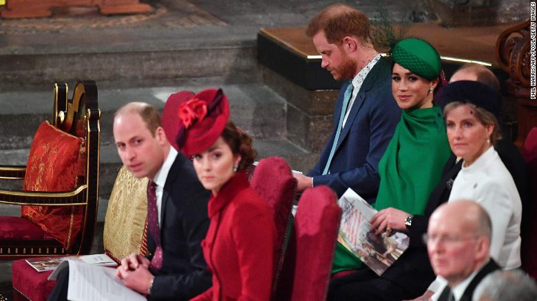 Harry, Meghan and Sophie, Countess of Wessex sit behind William and Kate inside Westminster Abbey.