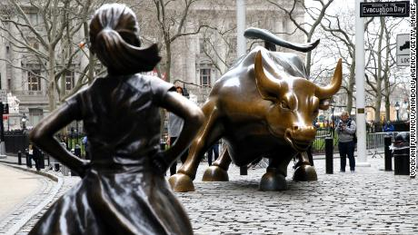 "NEW YORK, USA - MARCH 29: The ""Fearless Girl"" statue, a four-foot statue of a young girl, defiantly looks up the iconic Wall Street ""Charging Bull"" sculpture in New York City, United States on March 29, 2017.  ""Fearless Girl"" statue was installed in front of the bronze ""Charging Bull"" for International Women's Day earlier this month to draw attention to the gender pay gap and lack of gender diversity on corporate boards in the financial sector. The statue will remain at her post until February 2018. (Photo by Volkan Furuncu/Anadolu Agency/Getty Images)"