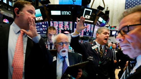 """Traders work on the floor of the New York Stock Exchange on March 9. <a href=""""https://www.cnn.com/2020/03/08/investing/stock-dow-futures-coronavirus/index.html"""" target=""""_blank"""">Stocks plummeted</a> as coronavirus worries and an oil price race to the bottom weighed on global financial markets."""