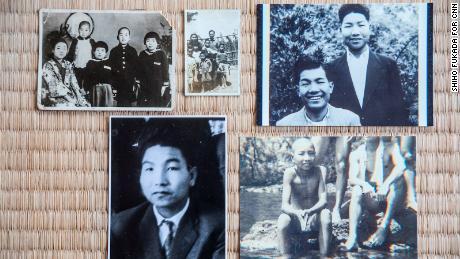 Photos of Iwao Hakamada spread along the tatami mat at his home in Hamamatsu.