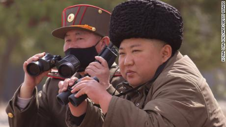 "This picture taken on March 9, 2020 and released from North Korea's official Korean Central News Agency (KCNA) on March 10, 2020 shows North Korean leader Kim Jong-Un (R) supervising a ""strike drill"" together with a high ranking officer wearing a mask, a test of long-range multiple rocket launchers and tactical guided weapons, in an undisclosed location in North Korea. - North Korean leader Kim Jong Un has overseen another ""long-range artillery"" drill, state media reported on Tuesday, a day after Japan said the nuclear-armed country had fired what appeared to be ballistic missiles. It was the second-such ""drill"" in a week and comes as a prolonged hiatus in disarmament talks with the United States drags on. (Photo by STR / KCNA VIA KNS / AFP) / South Korea OUT / ---EDITORS NOTE--- RESTRICTED TO EDITORIAL USE - MANDATORY CREDIT ""AFP PHOTO/KCNA VIA KNS"" - NO MARKETING NO ADVERTISING CAMPAIGNS - DISTRIBUTED AS A SERVICE TO CLIENTS / THIS PICTURE WAS MADE AVAILABLE BY A THIRD PARTY. AFP CAN NOT INDEPENDENTLY VERIFY THE AUTHENTICITY, LOCATION, DATE AND CONTENT OF THIS IMAGE --- /  (Photo by STR/KCNA VIA KNS/AFP via Getty Images)"