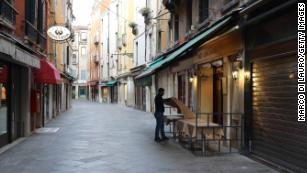 Cities deserted, families separated and social life on hold in Italy's first day of lockdown
