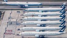 Cathay Pacific planes are seen parked on the tarmac in Hong Kong.