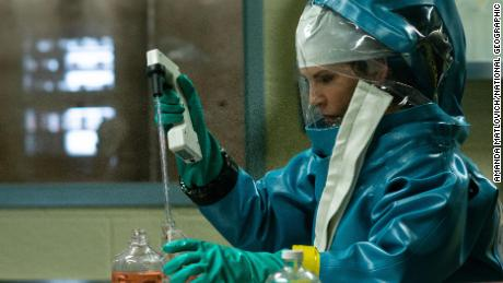 """Dr. Nancy Jaax (Julianna Margulies) works in her pathology lab in an episode of """"The Hot Zone.""""  (National Geographic/Amanda Matlovich)"""