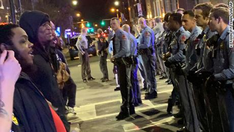 Demonstrators confront police at an intersection in Raleigh early Wednesday.