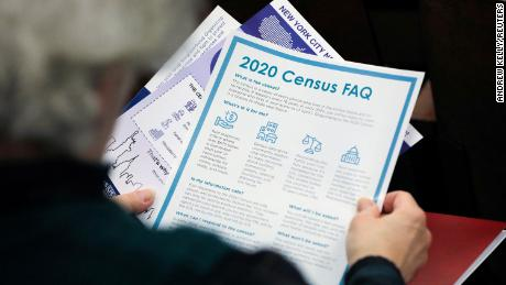 A person holds census information handed out at an event in New York City on February 22.