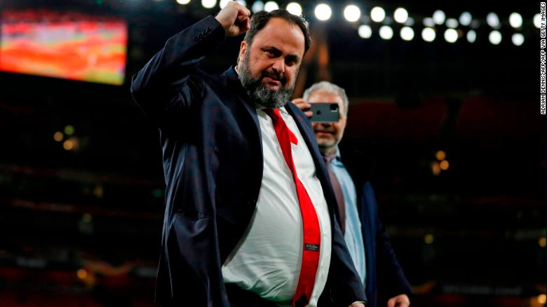 Evangelos Marinakis celebrates after Olympiacos' Europa league victory over Arsenal