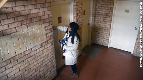 In anticipation of the 2020 census, advocates like Julia Aviles Zavala, shown here knocking on a door in Maryland in January, have been conducting outreach efforts to persuade immigrants and low-income residents to participate.