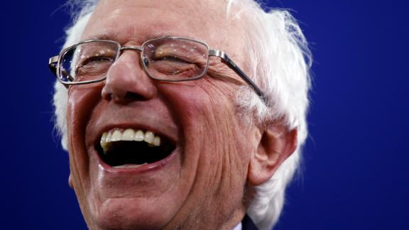 Sanders laughs during a primary-night rally in Manchester, New Hampshire, in February 2020. Sanders won the primary, just as he did in 2016.