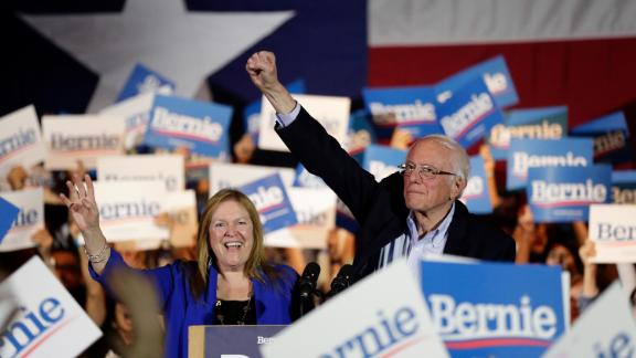 A triumphant Sanders raises his fist in San Antonio after he was projected to win the Nevada caucuses.
