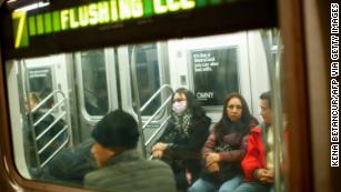 NYC keeps schools and subways open but cancels large events