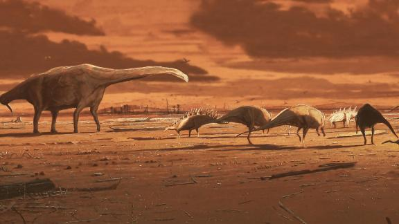 This is an artist's impression of dinosaurs on prehistoric mudflat in Scotland, based on varied dinosaur footprints recovered on the Isle of Skye.