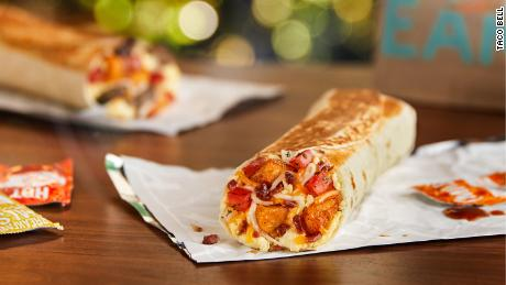 Taco Bell is adding three new toasted burritos to help it compete in the battle over breakfast.