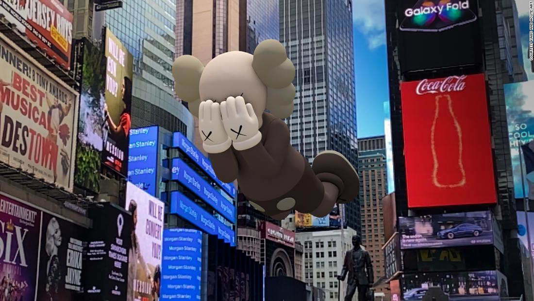 Large augmented-reality figures hover over Times Square