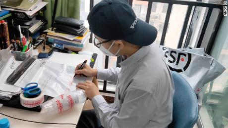 Henan province resident Andy Li packages HIV drugs for coronavirus sufferers who can use the medicine to treat their disease.