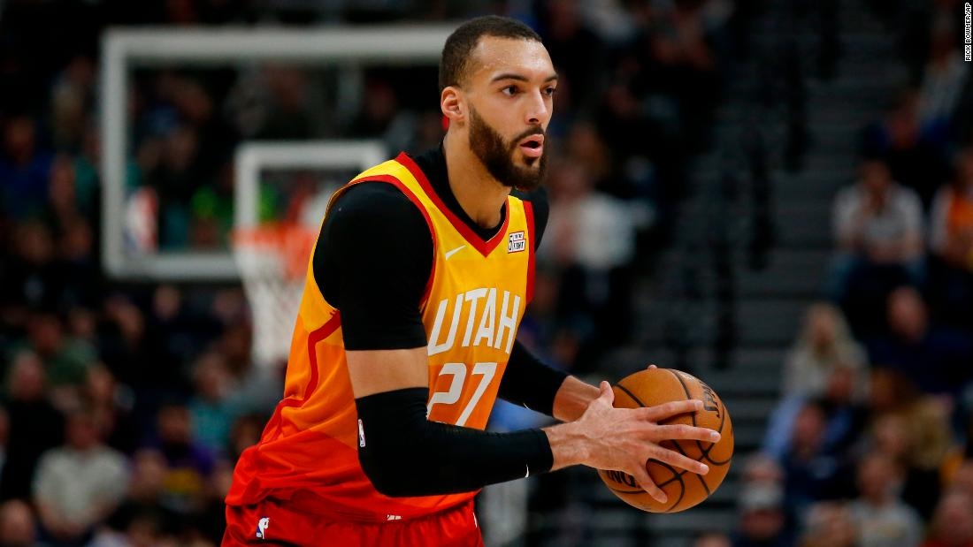 NBA player who touched microphones then tested positive pledges $500K