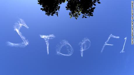 "The words ""Stop F1"" are seen over the Sydney sky."