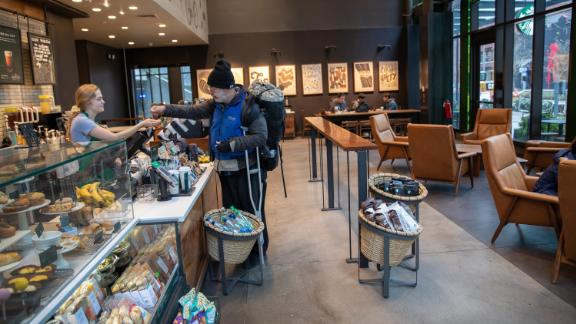 SEATTLE, WASHINGTON - MARCH 10: A Starbucks coffee shop sits mostly empty at Amazon headquarters on March 10, 2020 in downtown Seattle, Washington.