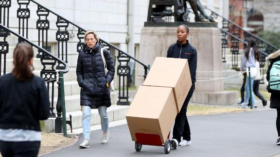 Sophomore Sadia Demby moves her belongings through Harvard Yard on March 12.
