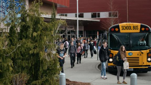 Students leave Glacier Peak High School in Snohomish, Washington, on March 12. Beginning the following day, schools in the Snohomish school district planned to be closed through April 24.