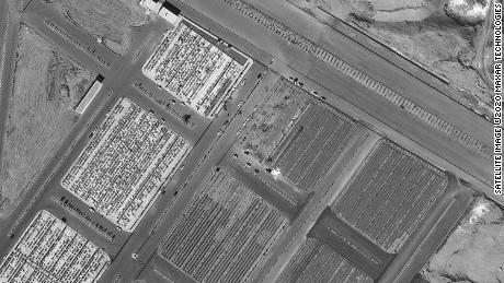 Satellite images of the Beheste Masoumeh cemetery in Qom, Iran after what appear to be new burial plots were dug that were not in the October images before the coronavirus outbreak. This black and white image appears to show increased vehicle activity, and that the new plots have been filled in.