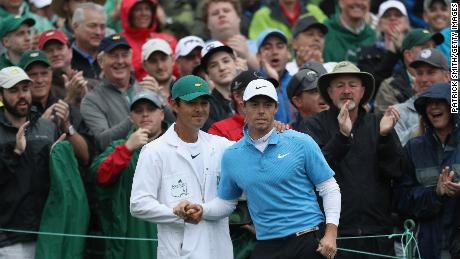 Rory McIlroy and caddie Harry Diamond shake hands on the 18th green during the third round of the 2018 Masters.