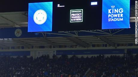 An advertisement warning people of the threat from the coronavirus is shown on the big screen at half-time during the English Premier League football match between Leicester City and Aston Villa.