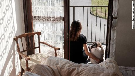 Life inside a red zone: Chiara Zuddas, 31, and her two year-old daughter Bianca Toniolo sit on a balcony at home in San Fiorano, one of the towns on lockdown due to a coronavirus outbreak, in this picture taken by Bianca's father and Chiara's husband, schoolteacher Marzio Toniolo in San Fiorano, Italy, February 28, 2020. Picture taken February 28, 2020. Marzio Toniolo via REUTERS THIS IMAGE HAS BEEN SUPPLIED BY A THIRD PARTY. MANDATORY CREDIT
