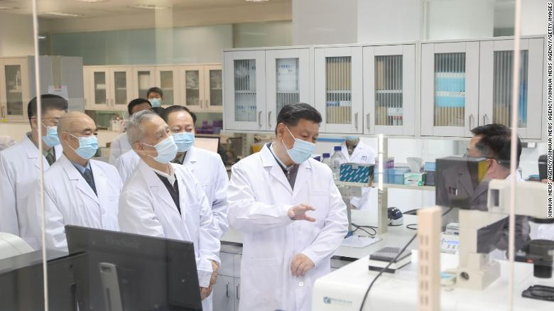 Chinese President Xi Jinping inspects scientific research on the coronavirus during his visit to the Academy of Military Medical Sciences in Beijing on March 2.
