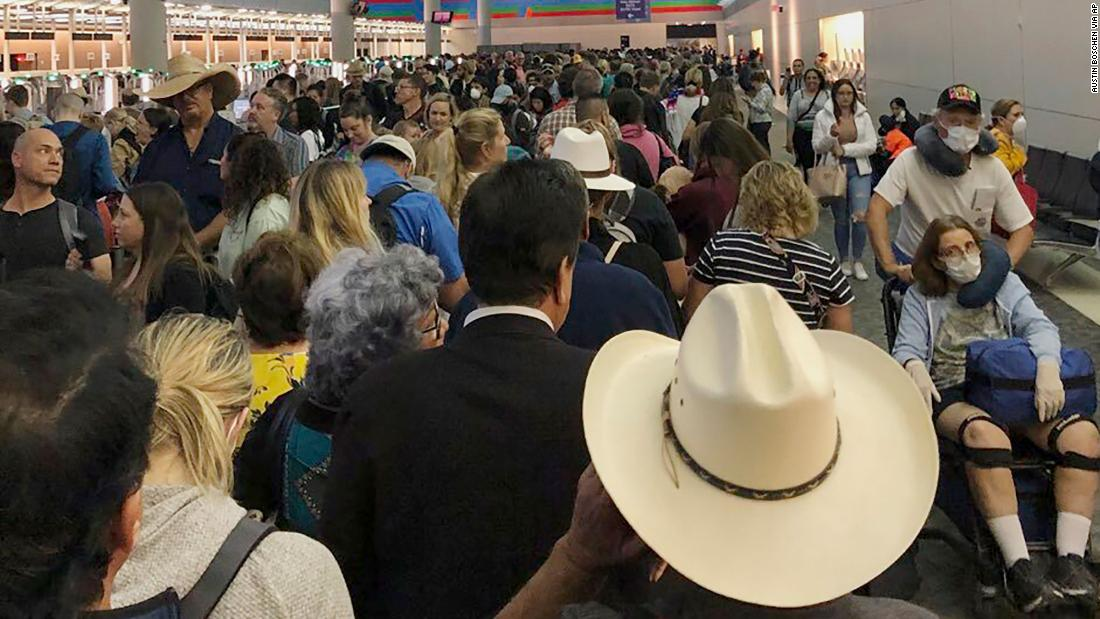 "People wait in line to go through customs at Dallas/Fort Worth International Airport on March 14. Travelers returning from Europe say they were <a href=""https://www.cnn.com/travel/article/coronavirus-airport-screening-sunday/index.html"" target=""_blank"">being made to wait for hours </a>at US airports, often in close quarters, as personnel screened them for the coronavirus."