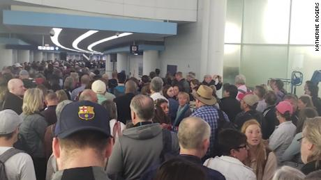 Airport travelers waited hours in screening lines over the weekend.