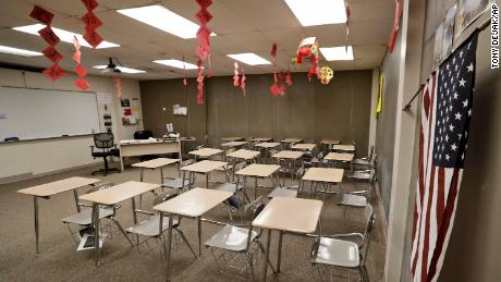 The empty world language room is shown at Orange High School, Thursday, March 12, 2020, in Pepper Pike, Ohio. Gov. Mike DeWine ordered all schools closed for three weeks beginning Monday. (AP Photo/Tony Dejak)