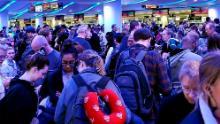Travelers returning from Madrid wait in a coronavirus screening line at Chicago's O'Hare International Airport on Saturday.