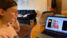 Rosalyn works on a lesson with a teacher online from home.