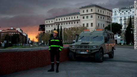 A member of the Spanish Military Emergency Unit (UME) stands guard near Madrid's Atocha train station on Sunday.