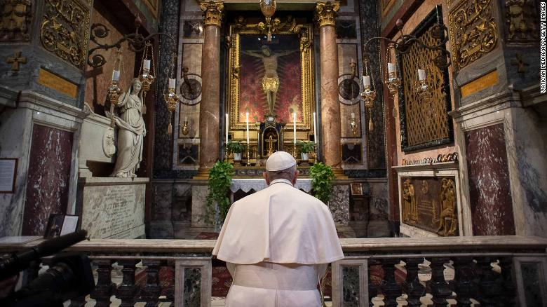 Pope Francis prays ast San Marcello al Corso church in Rome, home to a crucifix which believers say helped to end an outbreak of the plague in 1522.