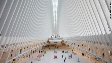 The Oculus at the World Trade Center's transportation hub is sparsely occupied, Monday, March 16, 2020 in New York. Millions of Americans have begun their work weeks holed up at home, as the coronavirus pandemic means the entire nation's daily routine has shifted in ways never before seen in U.S. history. (AP Photo/Mark Lennihan)