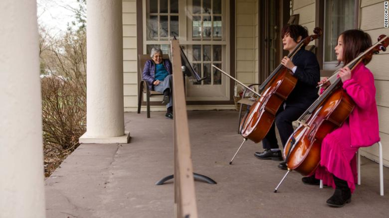 Taran and Calliope Tien playing the cello for Helena Schlam.