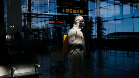 A member of Spain's Military Emergencies Unit carries out a general disinfection at the Malaga airport on Monday, March 16.