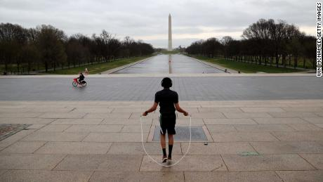 WASHINGTON, DC  - MARCH 17: Zef Talahun jumps rope on the plaza in front of the Lincoln Memorial, normally filled with tourists, but now nearly empty due to the impacts of coronavirus (COVID-19) on March 17, 2020 in Washington, DC. U.S. President Donald Trump announced new guidelines yesterday intended to slow the spread of the virus in the next 15 days, including avoiding gatherings of more than 10 people, avoiding restaurants and bars, and avoiding unnecessary travel where possible. (Photo by Win McNamee/Getty Images)