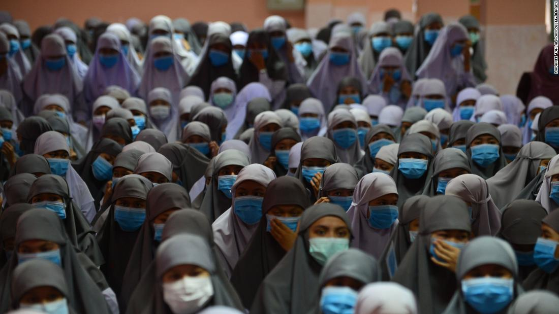 Students at the Attarkiah Islamic School wear face masks during a ceremony in Thailand's southern province of Narathiwat on March 17.