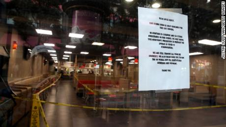 Stores and restaurants posted signs outside informing customers that they are closed.