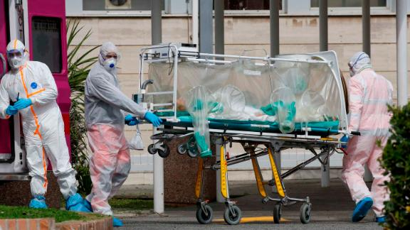 A patient in a biocontainment unit is carried on a stretcher in Rome on March 17.