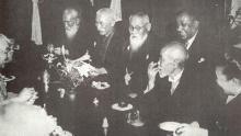 A dinner party held in honor of Bose in 1915 by his close Japanese friends, including Mitsuru Tōyama (centre, behind the table), and Tsuyoshi Inukai (to the right of Tōyama). Bose is pictured behind Tōyama is Bose.