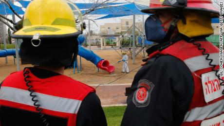 An Israeli firefighter sprays disinfectant in a children's playground in Modiin on Tuesday.