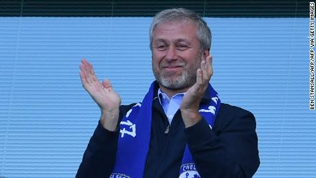 Roman Abramovich applauds as Chelsea players celebrate their league title win at Stamford Bridge in London on May 21, 2017.