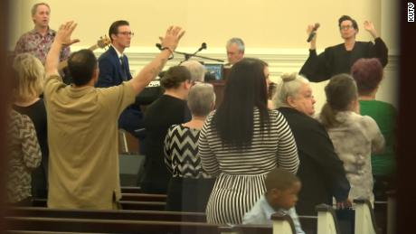 A Louisiana pastor defies a state order and holds a church service with hundreds of people